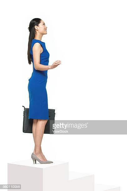Business woman standing on the stairs
