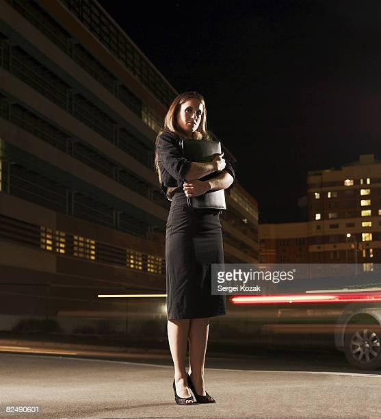Business woman standing on urban street