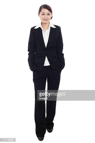 business woman standing with white background - zwart pak stockfoto's en -beelden