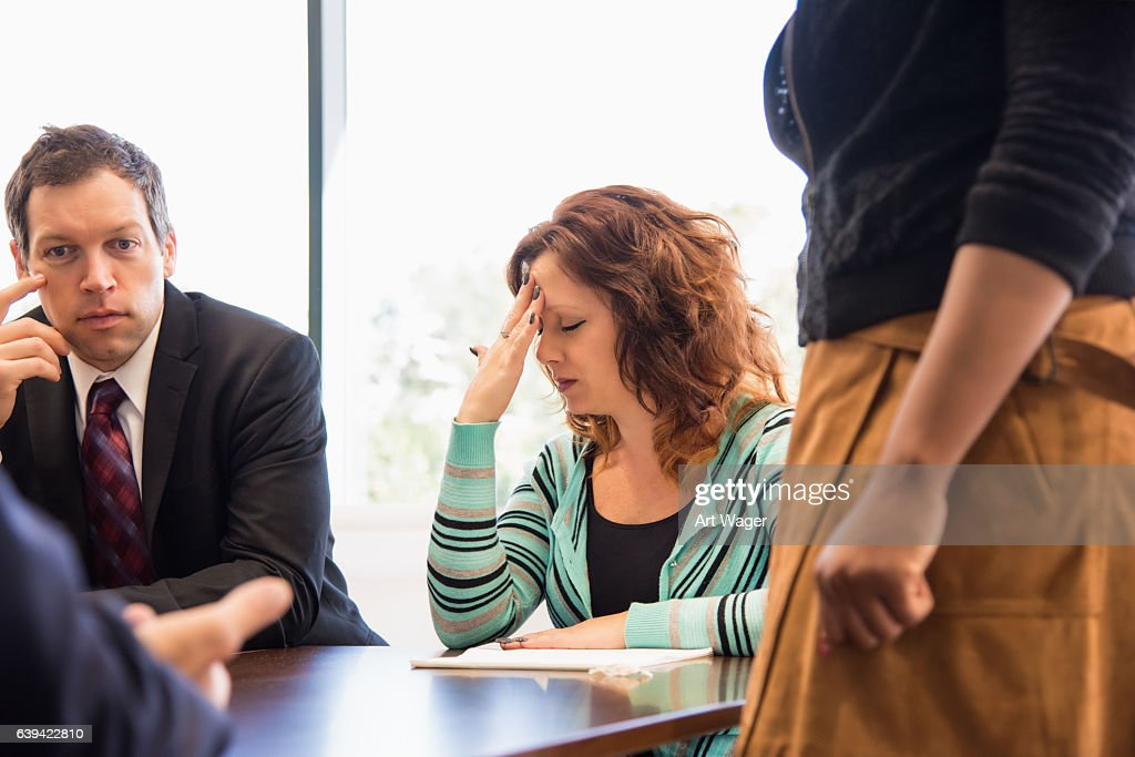 Business Woman Stressed During Team Meeting : Stock Photo