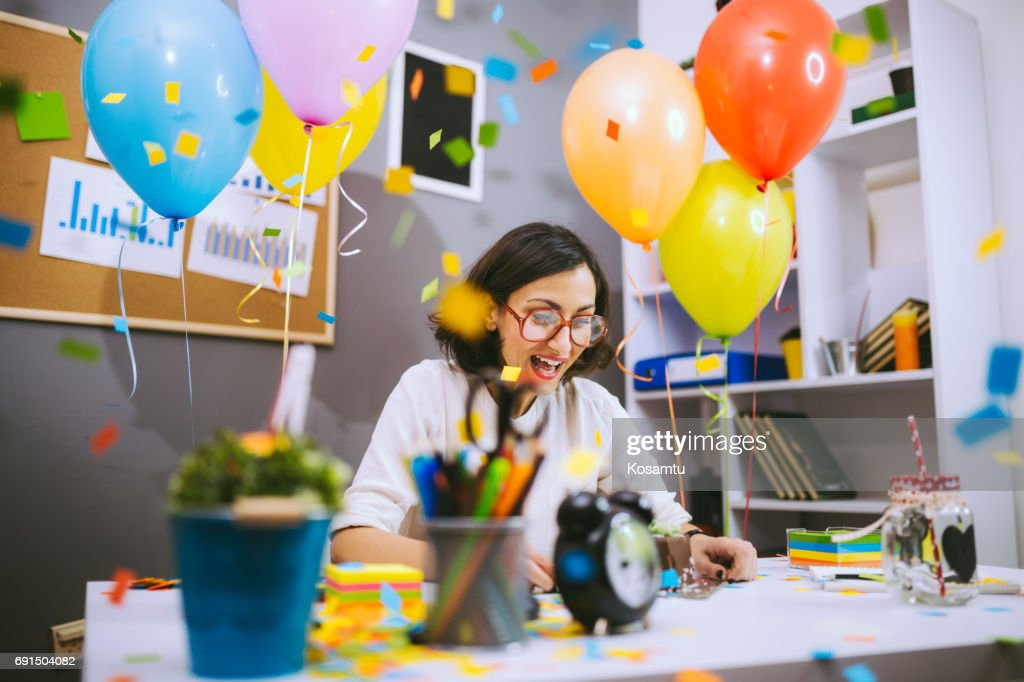 Business Woman Summarizing Impression Of Her Own Birthday Party At Work : Stock Photo