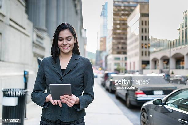 business woman surfing on the phone - urban scene