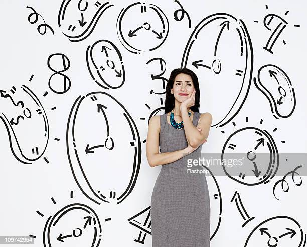 Business woman surrounded by clocks