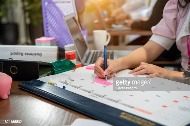 business woman take notes in the calendar for make report or mea - week stock pictures, royalty-free photos & images