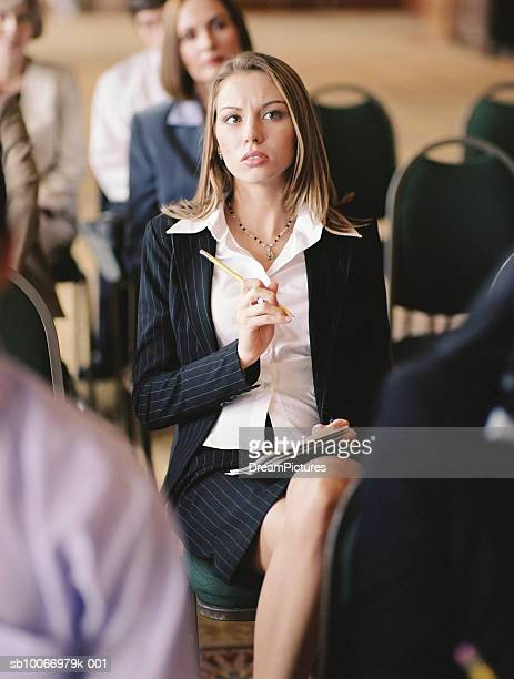Business woman taking notes at conference