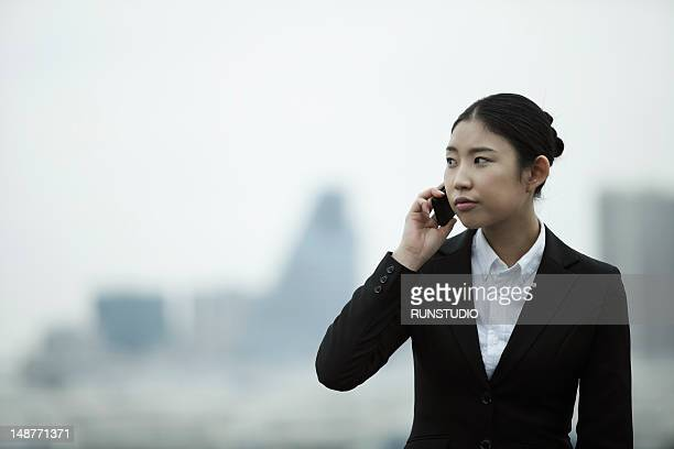business woman talking mobile phone