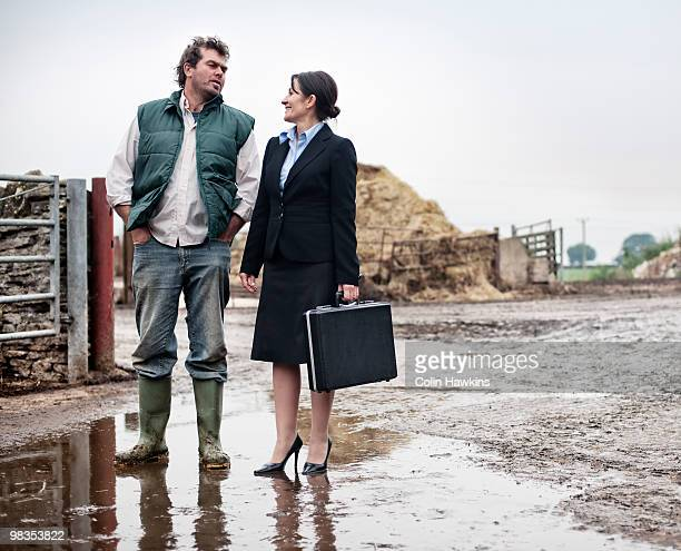 business woman talking to farmer