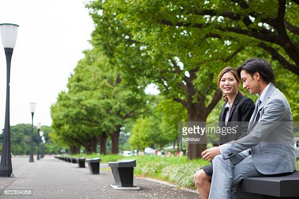 Business woman talking with a lover in a park