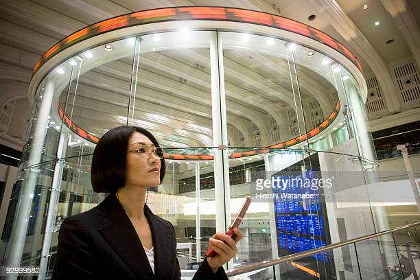 Business woman text messaging on cellular phone