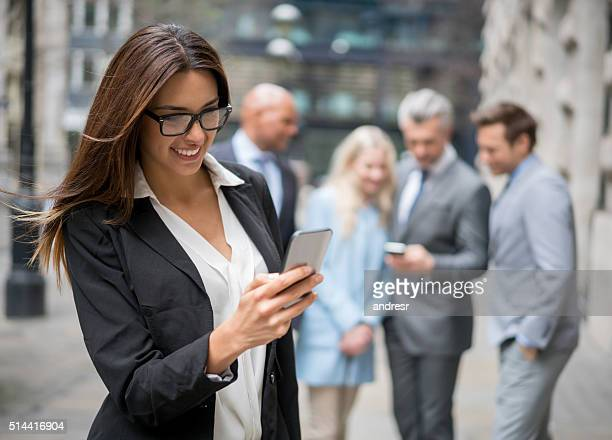 Business woman texting on her phone