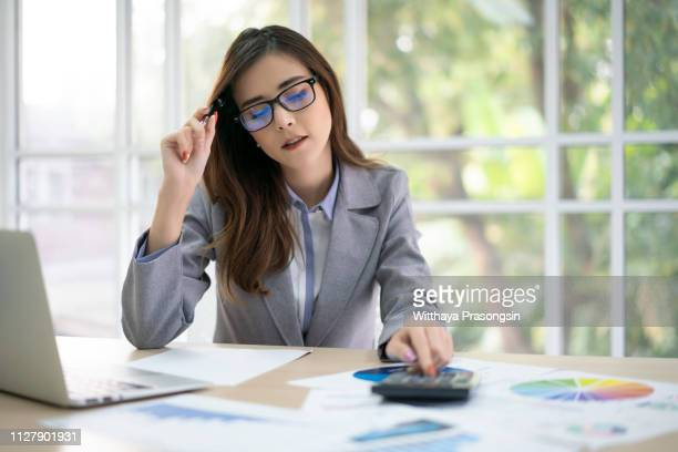 business woman thinking account - bill legislation stock pictures, royalty-free photos & images