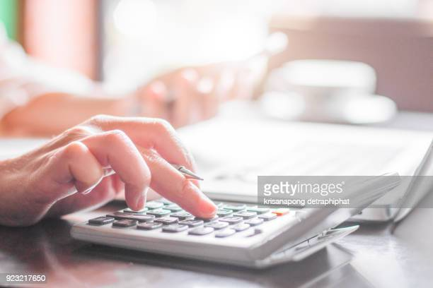 business woman thinking account - calculator stock photos and pictures