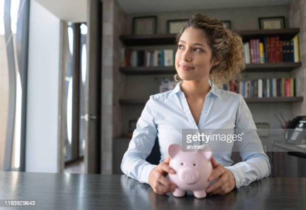 business woman thinking how to spend her savings - formal imagens e fotografias de stock