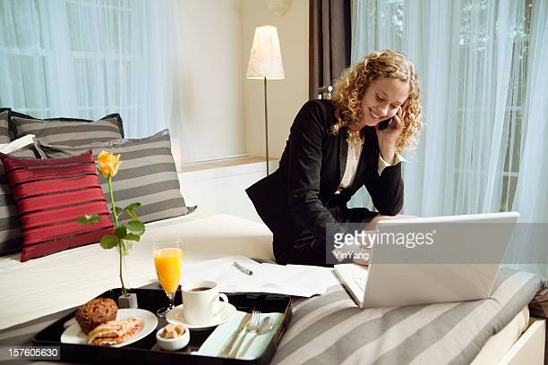 Business Woman Traveler Working in Hotel with WIFI and Laptop