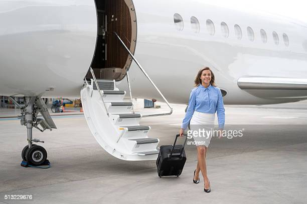 Business woman traveling by air
