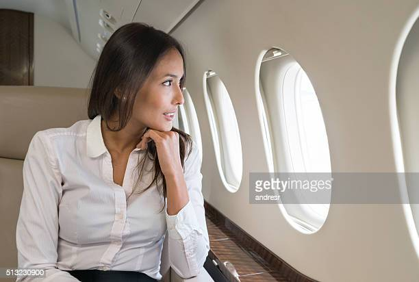 Business woman traveling by plane
