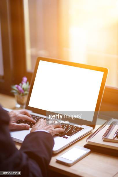 business woman typing laptop at workplace