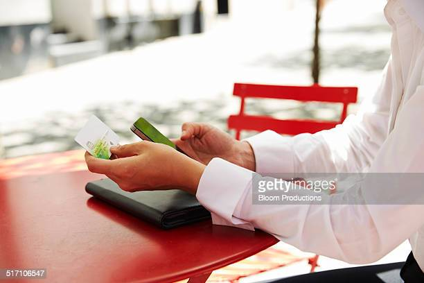 Business woman using a credit card