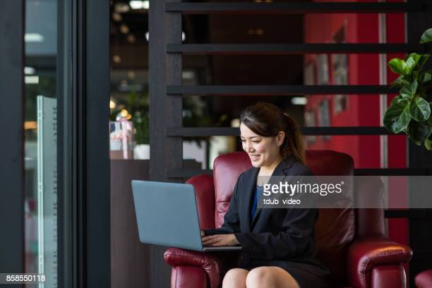 A business woman using a laptop
