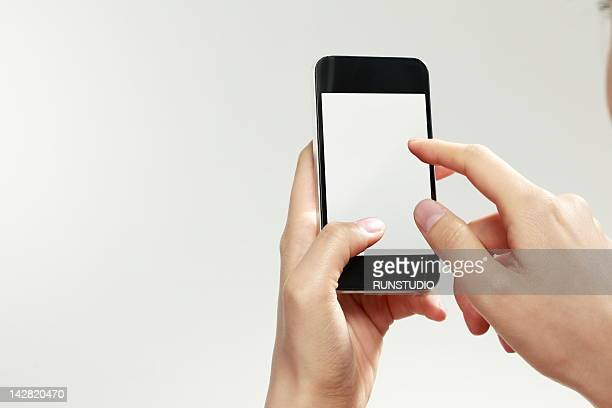 business woman using digital phone,close-up