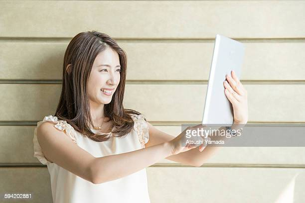 Business woman using digital tablet,smiling