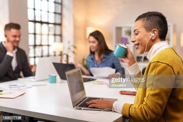 business woman using laptop in the office - incidental people stock pictures, royalty-free photos & images