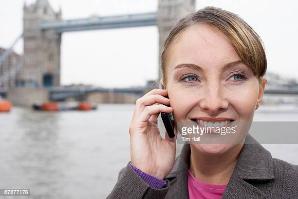 Business woman using mobile outside