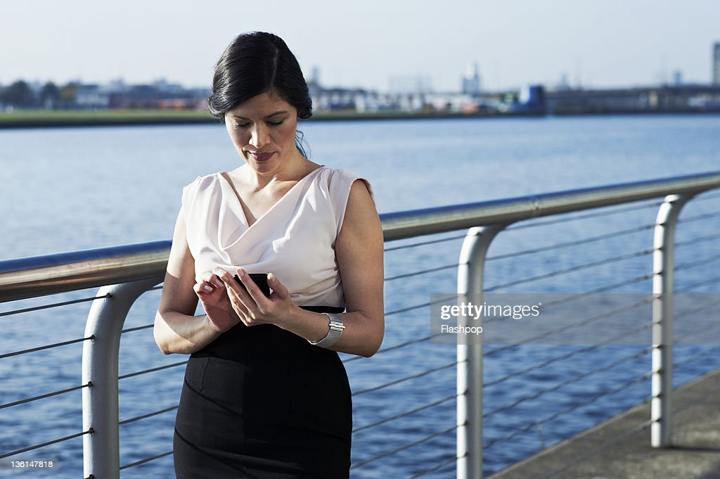 Business woman using mobile phone : Stock Photo