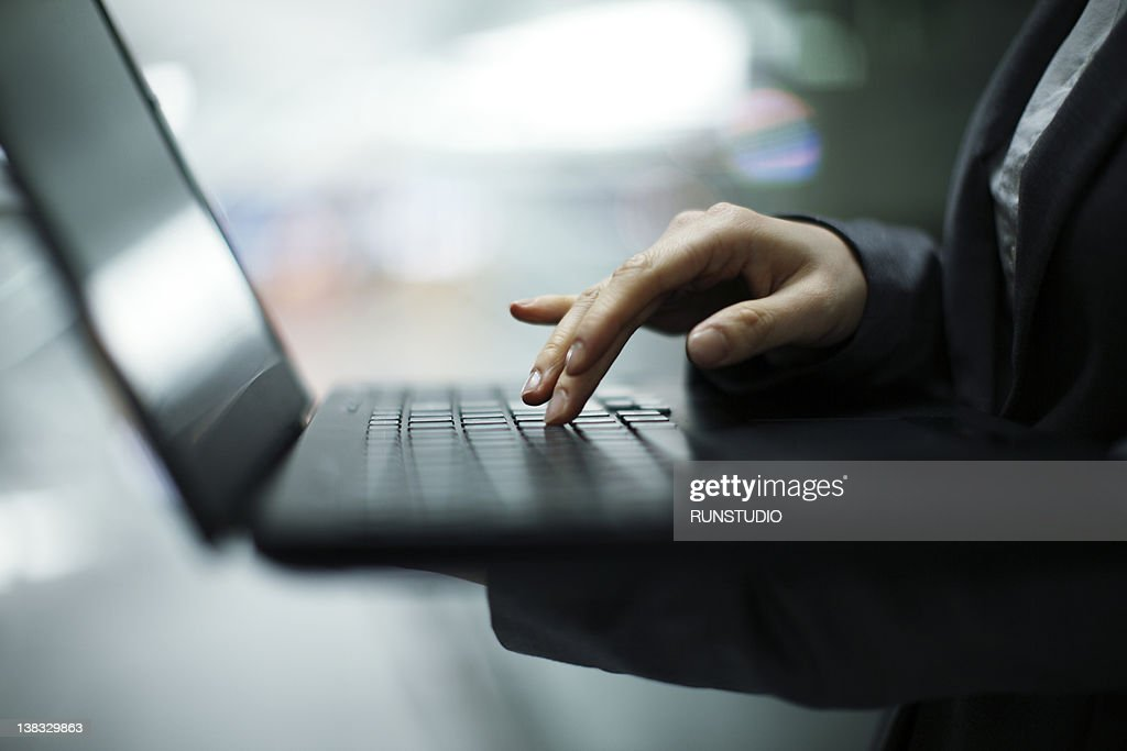business woman using notebook PC,hands close-up : Stock Photo