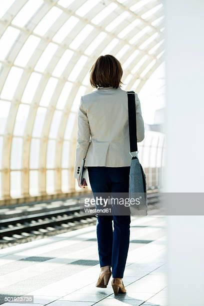 Business woman waiting on platform
