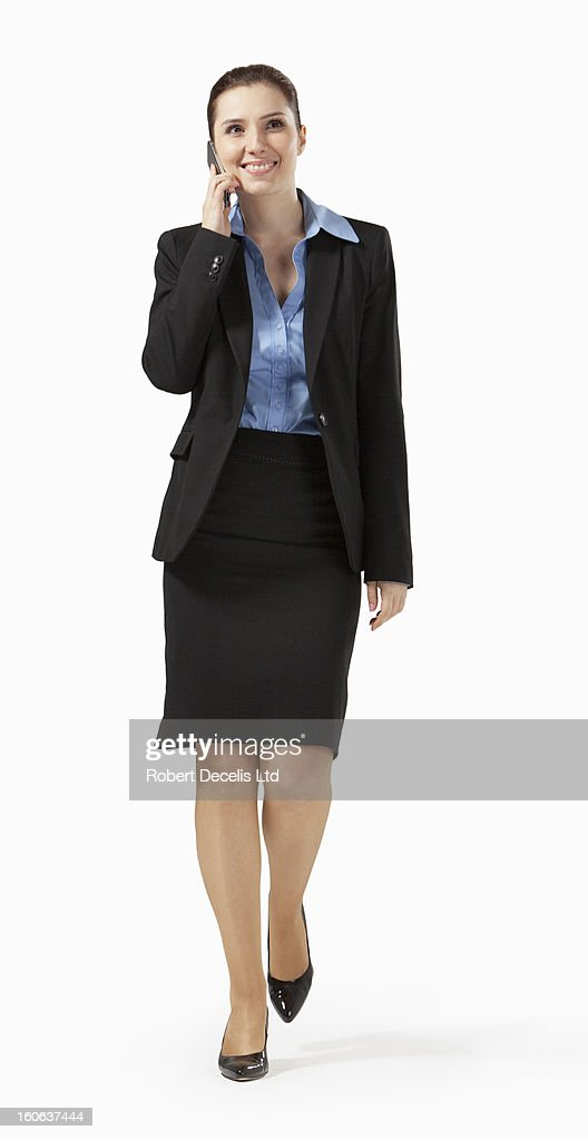 Business woman walking along chatting on phone : Foto de stock