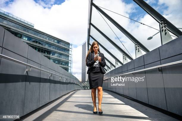 Business woman walking in in Sydney downtown district