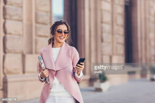 Business woman walking in the city