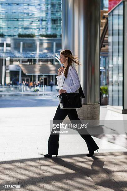 Business woman walking in the financial district