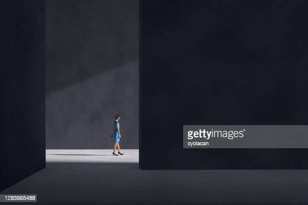 business woman walking towards the sunlight - syolacan stock pictures, royalty-free photos & images