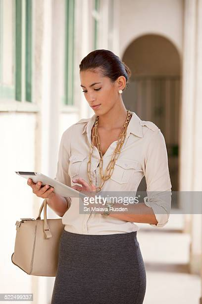 Business woman watches movie on ipad
