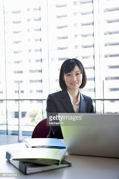 A business woman who is making arrangements