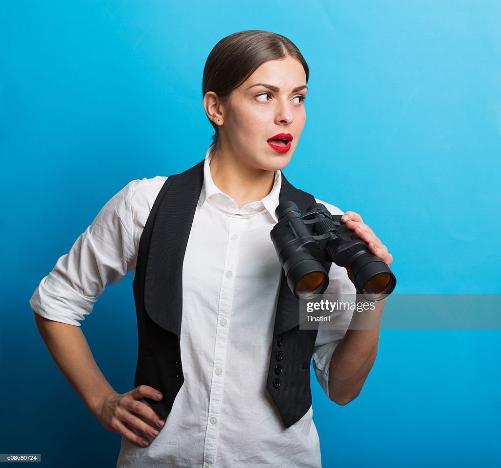 Business woman with a binoculars : Stock Photo