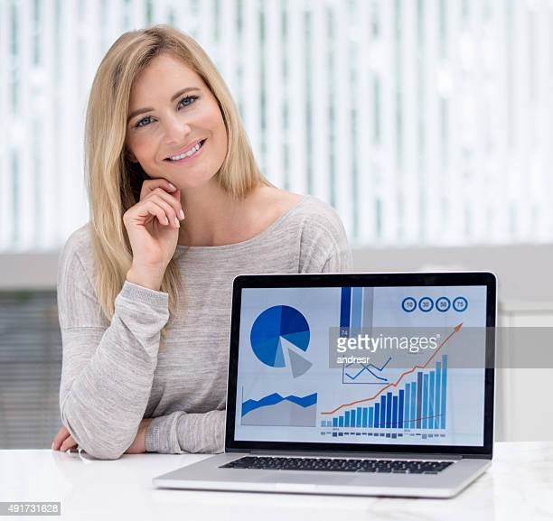business woman with a graph on a laptop - bar graph stock pictures, royalty-free photos & images