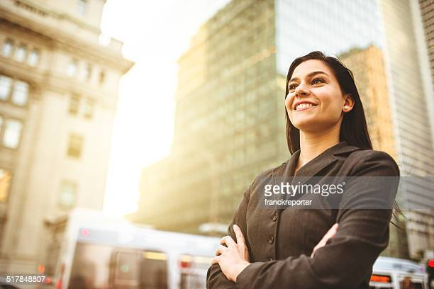 business woman with arm crossed on urban scene