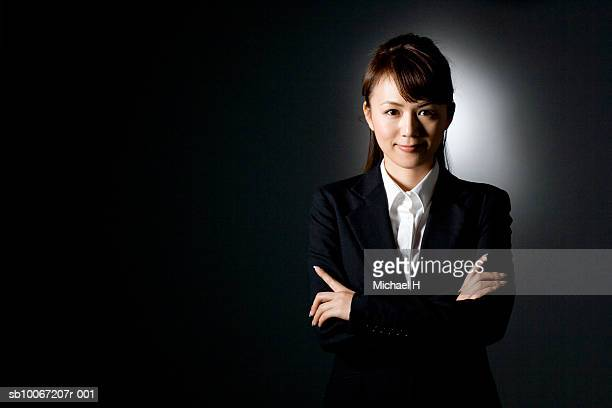 Business woman with arms crossed, smiling, portrait