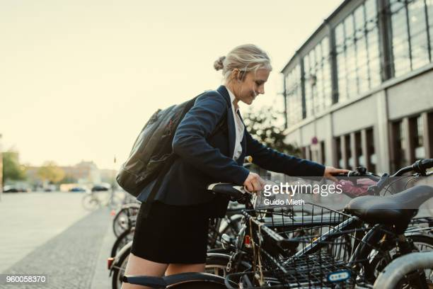 Business woman with bicycle in the city.