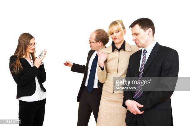 Business Woman With Bunch Of Dollars Making Colleagues Jealous