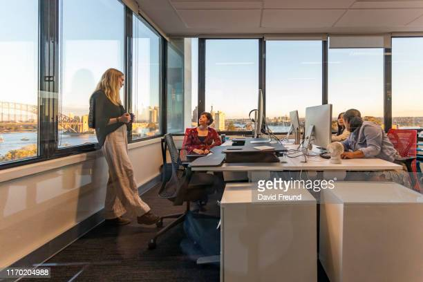 business woman with cerebral palsy having a casual office meeting - david freund stock pictures, royalty-free photos & images