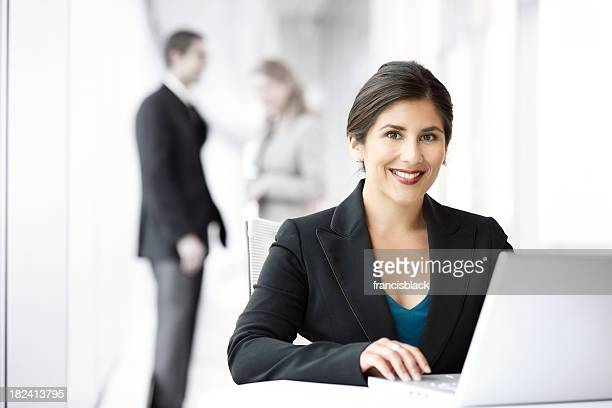 Business woman with computer and team