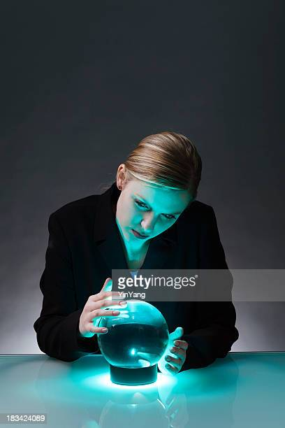 Business Woman With Crystal Ball Predicting Economic and Market Future