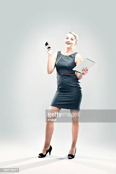 ビジネスの女性、デジタルタブレット、携帯電話