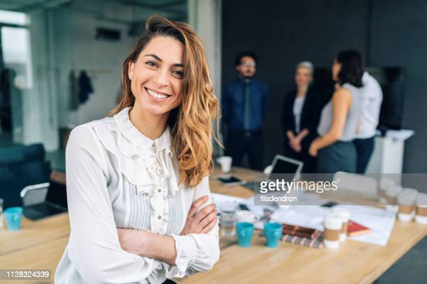 business woman with his team behind - well dressed stock pictures, royalty-free photos & images