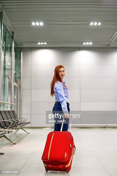 business woman with luggage in airport