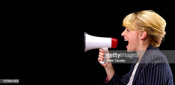 Business woman with megaphone with copy space